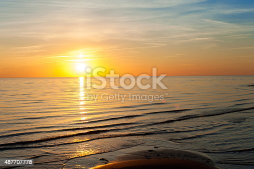 1083309578 istock photo Multicolored summertime sunset on Baltic sea. Horizontal outdoors image 487707778
