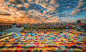 Multi-colored tents in Market train a second-hand market at sunset in Bangkok, Thailand