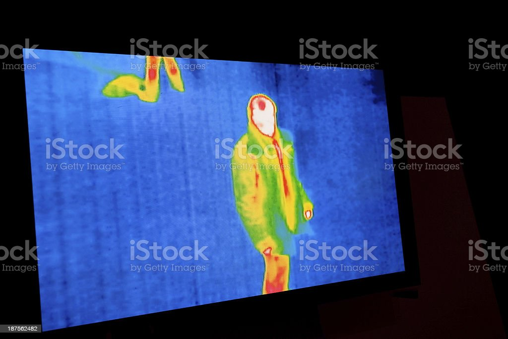 Multicolored thermal image of person on blue background stock photo