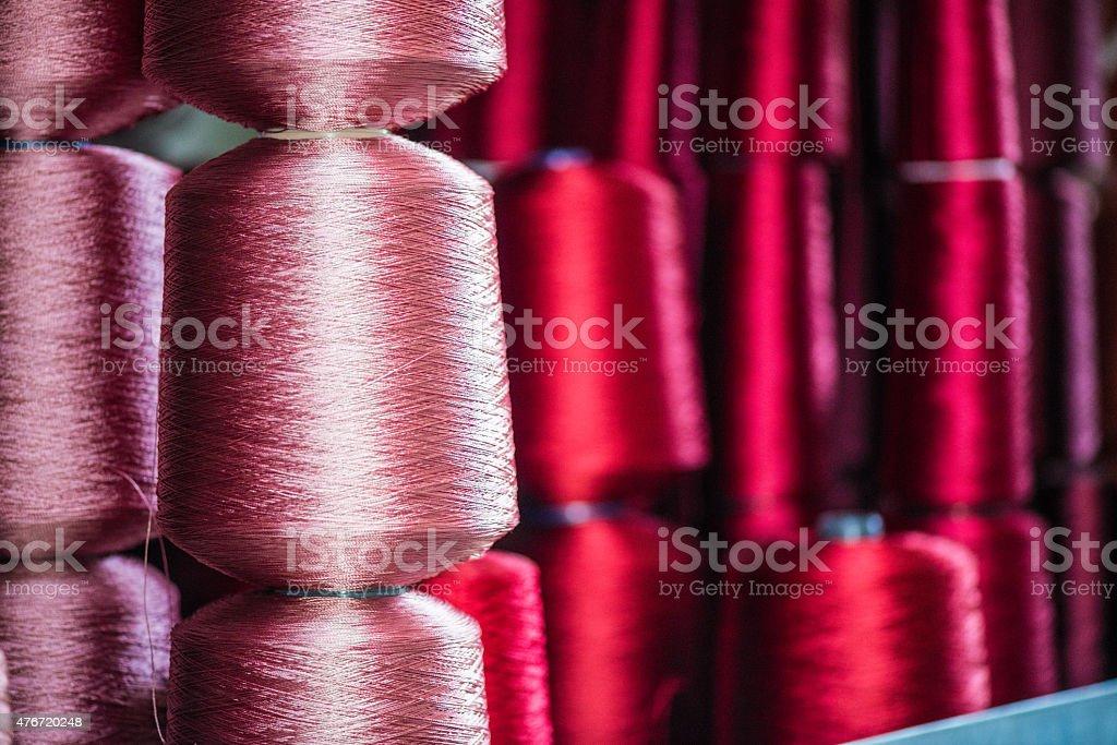 Multicolored thread spool in storehouse shelf stock photo