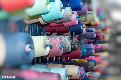 Multicolored thread spool in storehouse shelf