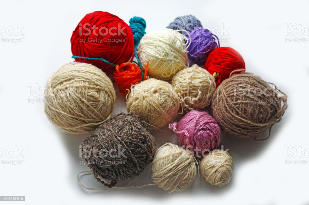 Multicolored threads for knitting and crocheting lie on a white background stock photo
