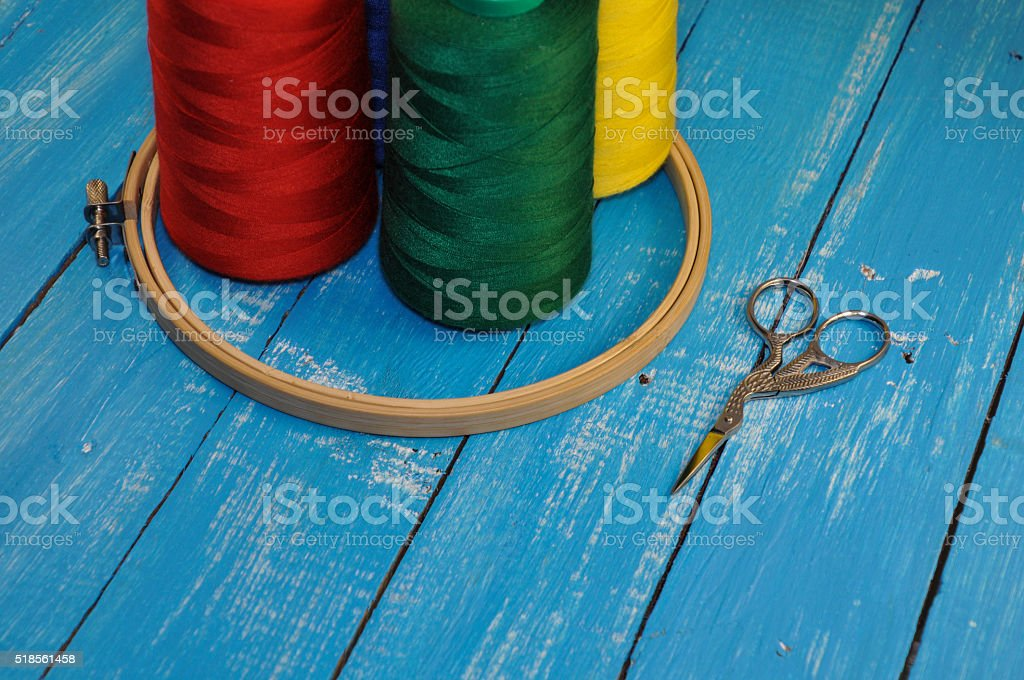 Multicolored threads, hoop and scissors for sewing and embroider stock photo