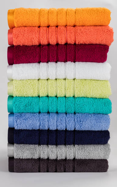 Multicolored towels on a white background stock photo