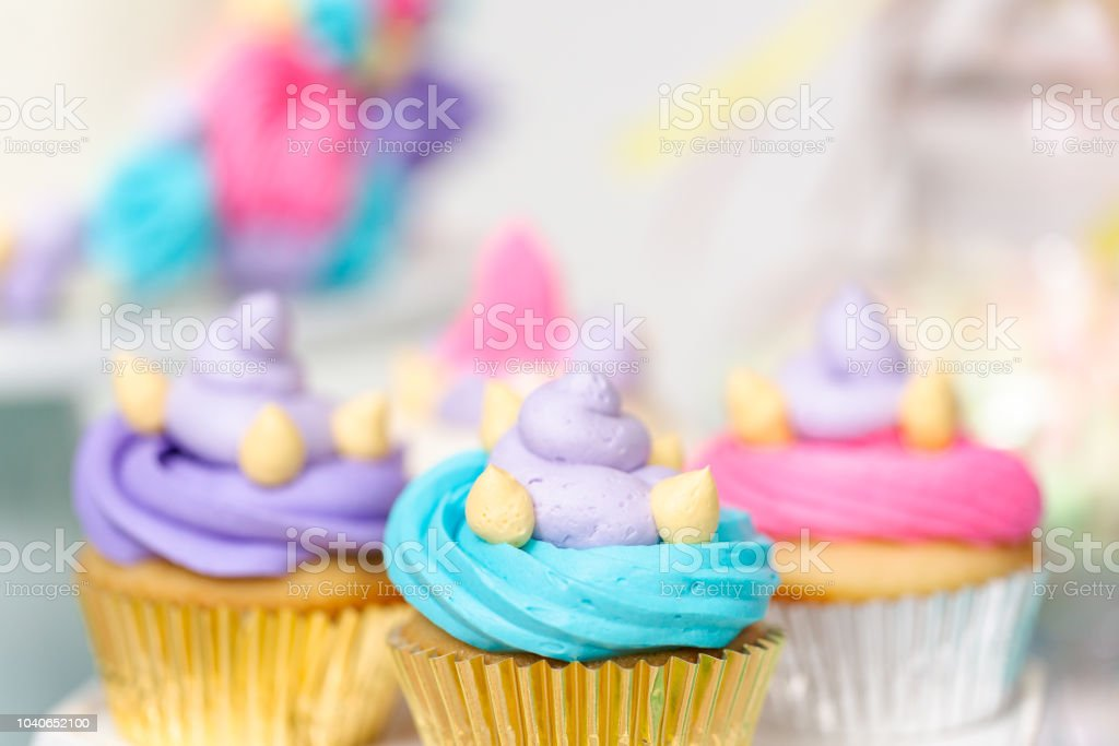 Multicolored Unicorn Cupcakes At Little Girl Birthday Party