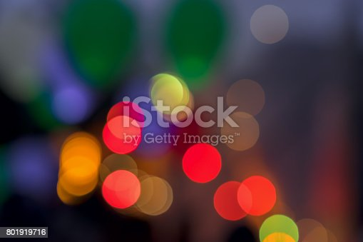 istock Multicolored vivid glowing Bokeh lights background from LED balloons flying fly away in the sky at night. Abstract background for all occasions, especially festive 801919716