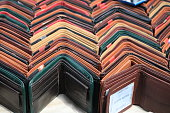 istock Multicolored wallets of various designs grouped together in rows 1139125522