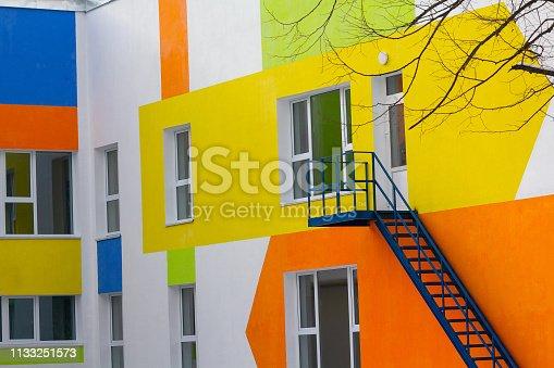Multi-colored windows of the school in a contemporary style. Architecture