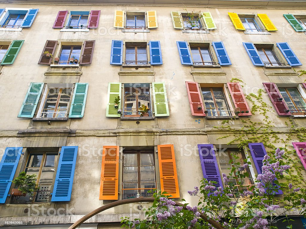 Multicolored windows on facade of a house royalty-free stock photo