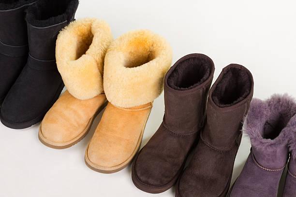 multicolored winter boots on a white background. - lammfellstiefel stock-fotos und bilder