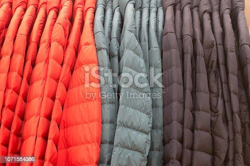 multicolored winter coat on sale in department store, multicolored winter coat background