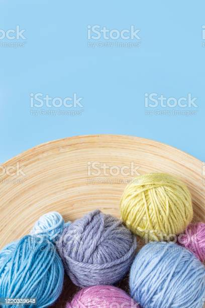 Multicolored woolen balls in bowl blue background picture id1220339648?b=1&k=6&m=1220339648&s=612x612&h=w9w62z ay5rvdchfnwfznkxrp30cn6ecuul2kt kkvi=