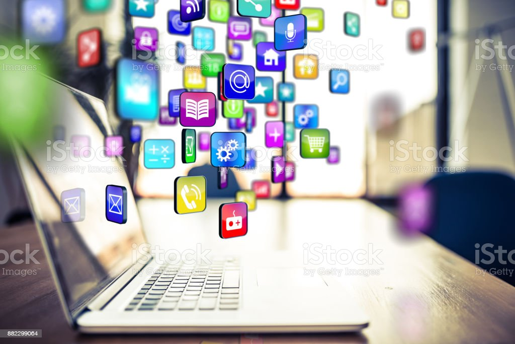 multicoloured applications flying out or into a laptop stock photo