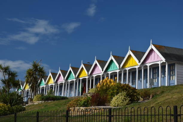 multi-coloured beach huts at weymouth in the morning - slight zoom - weymouth stock photos and pictures