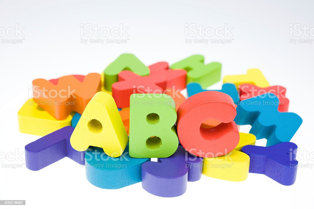 multicoloured bright wooden letters stock photo