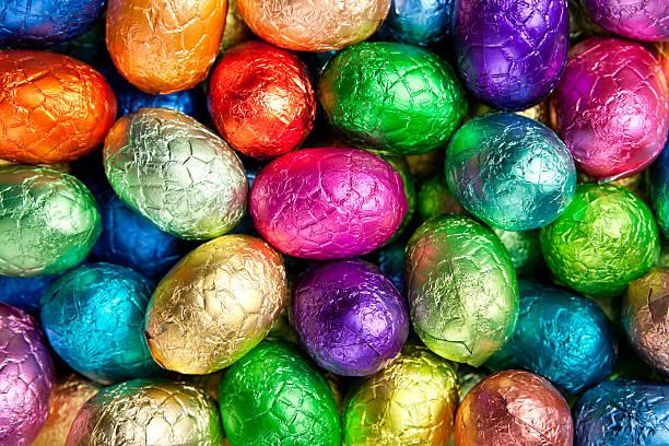 Multi-coloured chocolate Easter eggs stock photo
