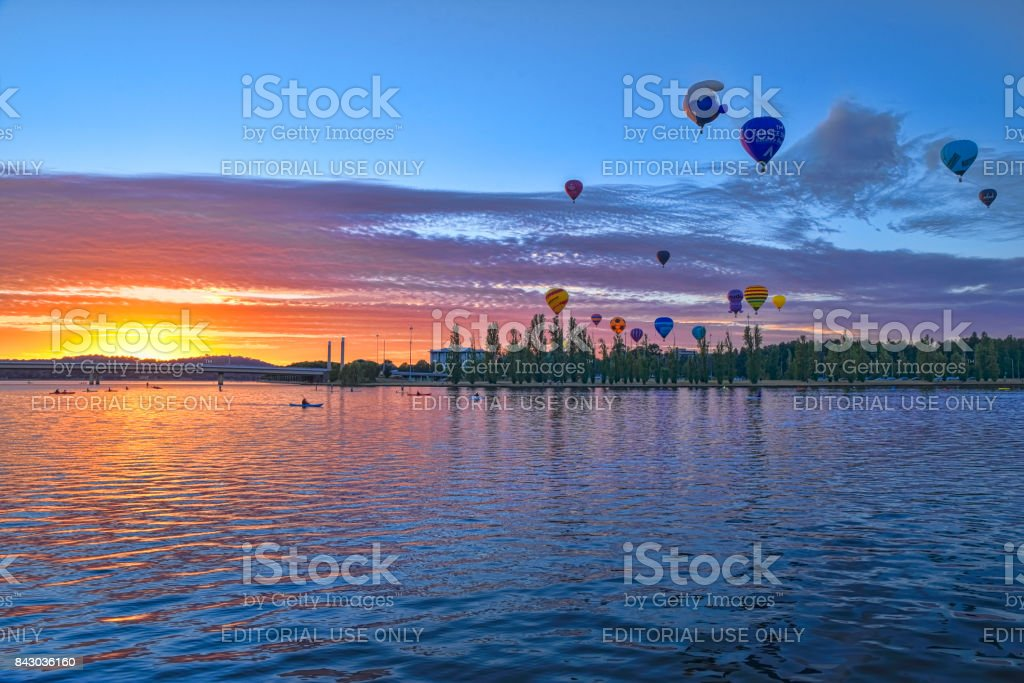 Multicoloured hot air balloons are launched in Canberra at sunrise stock photo