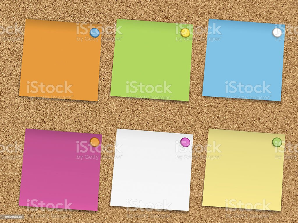 Multicoloured Note Paper on corkboard royalty-free stock photo