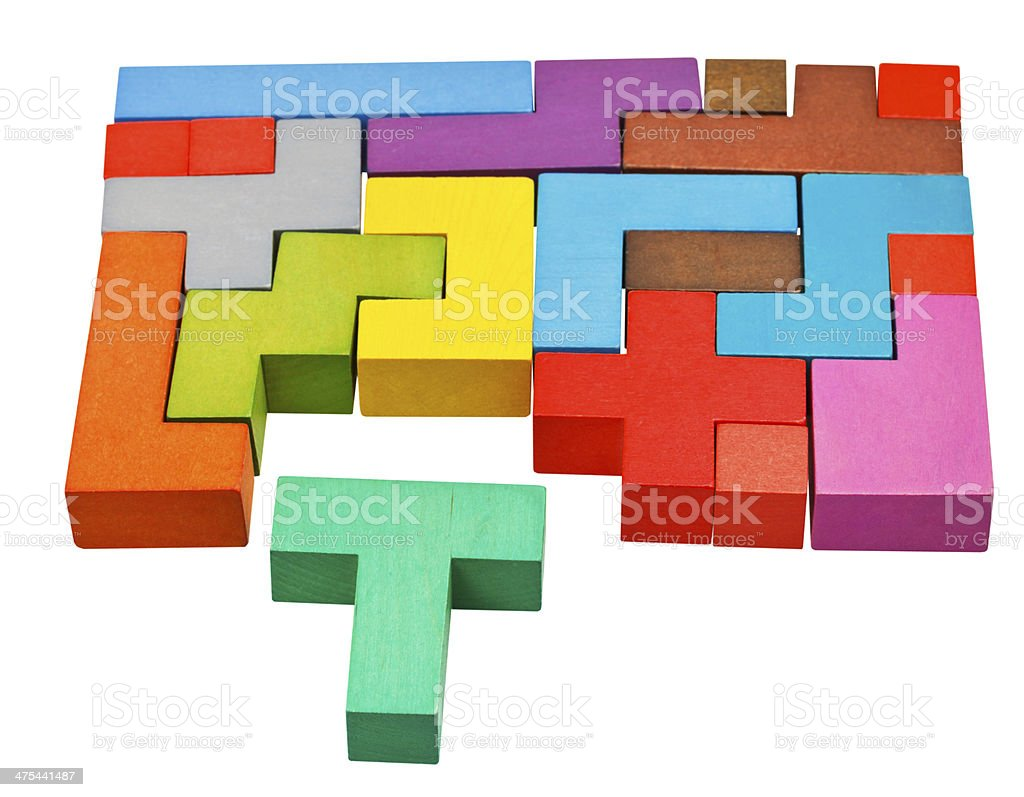 multicoloured puzzle blocks and T-shaped piece stock photo