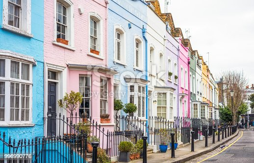 A street in the Chelsea area of central London, with each house painted a different pastel colour.