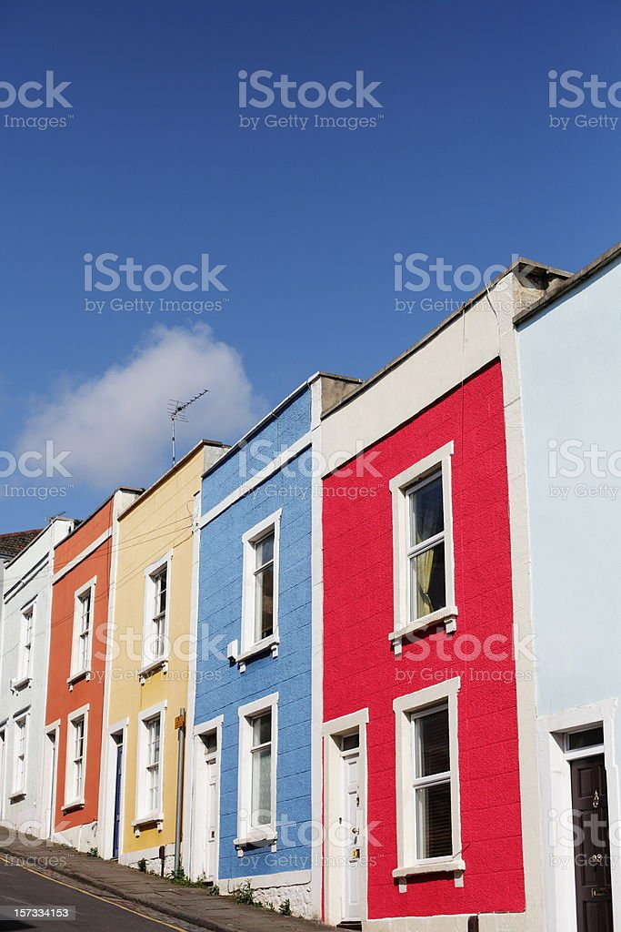 Multi-coloured Terrace Houses on Steep Hill stock photo