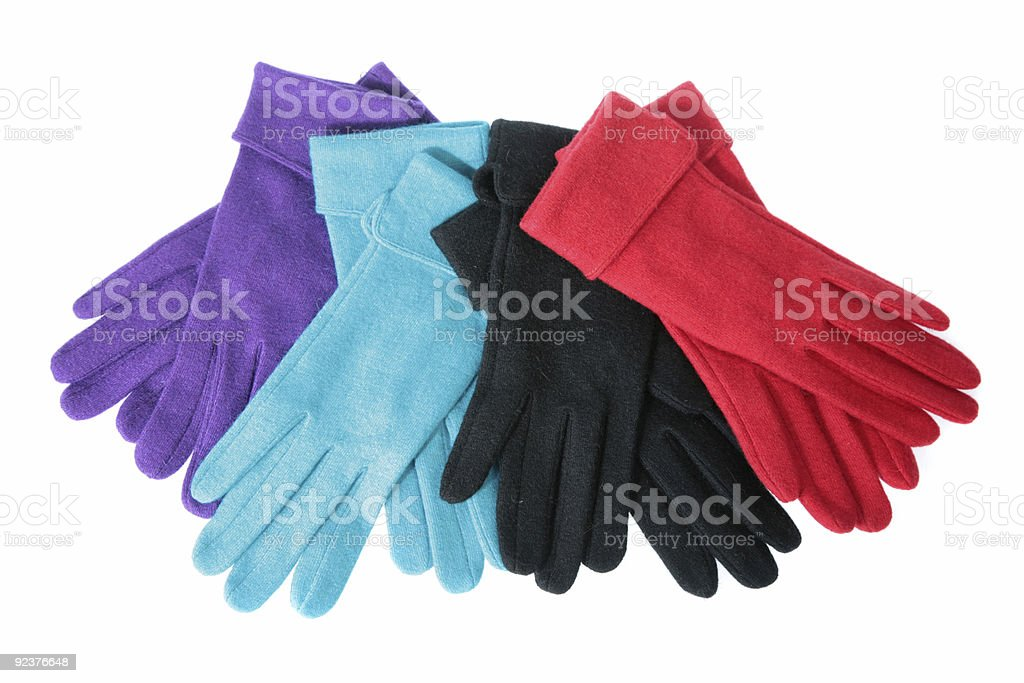 Multi-coloured woollen gloves on a white background royalty-free stock photo