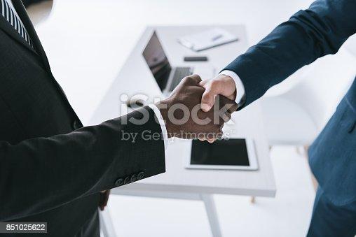 istock multicultural businessmen handshake 851025622