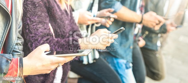 istock Multicultural friends group using smartphone at university college backyard break - People hands addicted by mobile smart phone - Technology concept with always connected millenials - Bright filter 1095982400