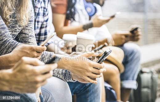istock Multicultural friends group using smartphone with coffee at university college break - People hands addicted by mobile smart phone - Technology concept with connected trendy millennials - Filter image 911294484