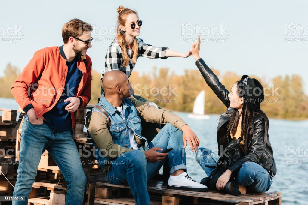 multicultural friends stock photo