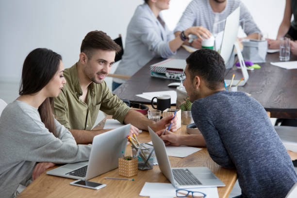 multicultural group of employees brainstorming - imobiliaria imagens e fotografias de stock