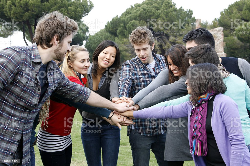 Multicultural Group of People with Hands on Stack stock photo