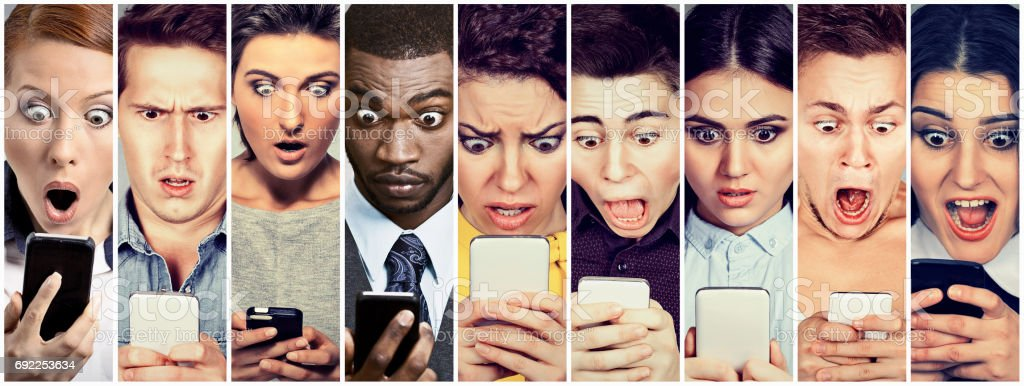 Multicultural group of young people men and women looking shocked at mobile phone stock photo