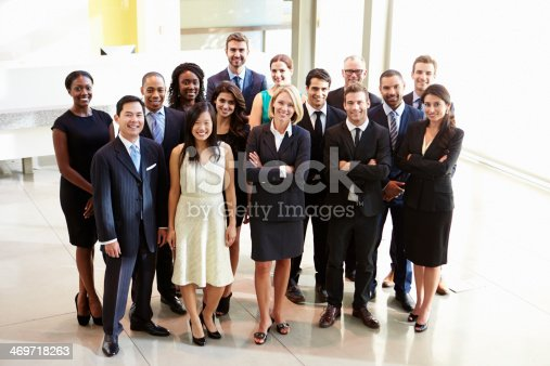 istock Multicultural office staff posing for picture in white lobby 469718263