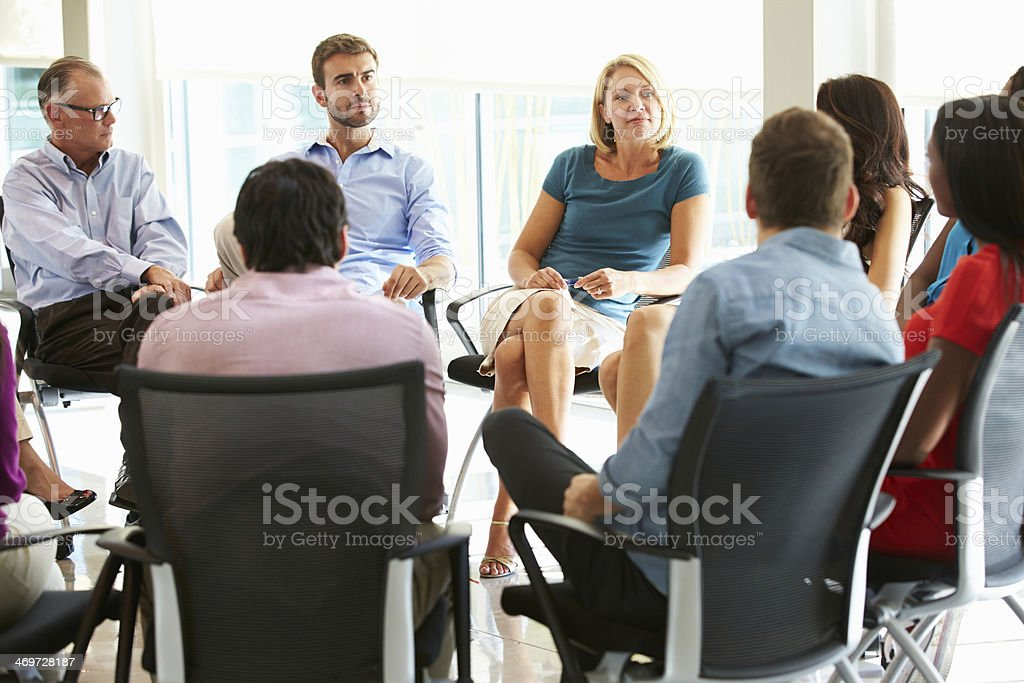 Multi-Cultural Office Staff Sitting Having Meeting Together royalty-free stock photo