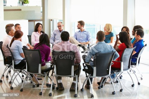 504879112istockphoto Multi-Cultural Office Staff Sitting Having Meeting Together 469737767