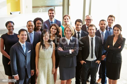 504879112istockphoto Multi-cultural office staff standing in lobby 469735239
