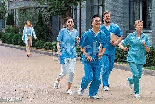 multicultural students running near medical university