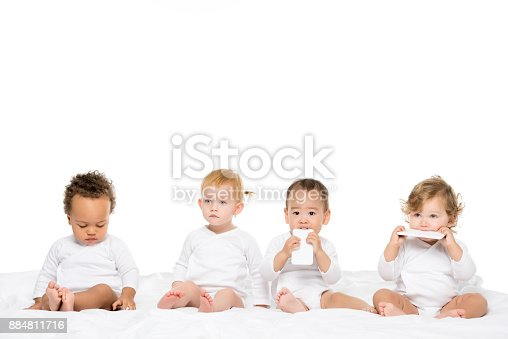 istock multicultural toddlers holding smartphones 884811716