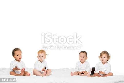 istock multicultural toddlers holding smartphones 884811726