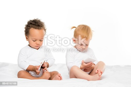istock multicultural toddlers with digital smartphones 884816166