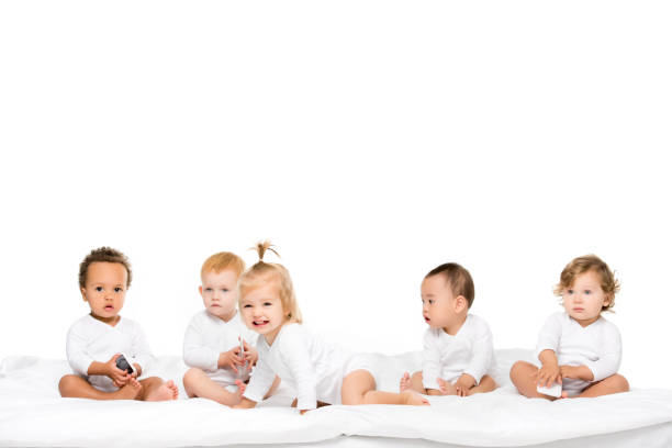 multicultural toddlers with smartphones stock photo