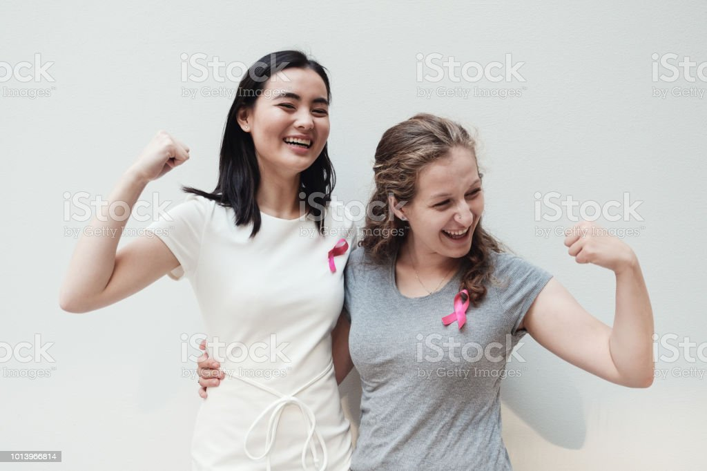 multicultural young women with pink ribbons, breast cancer awareness, October pink concept stock photo