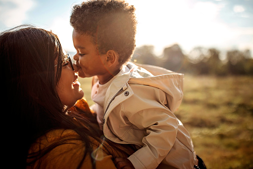Multi-ethic mother and son spending time together outdoors