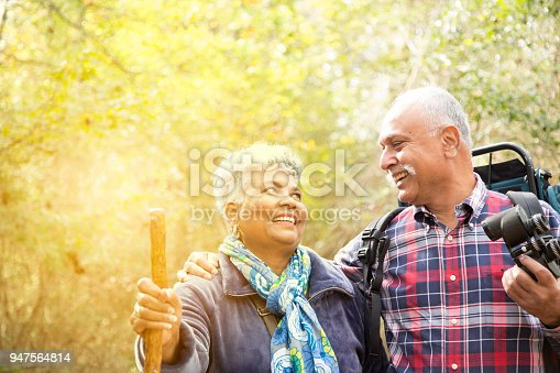 istock Multi-ethnic, active senior adult couple hiking in wooded forest area. 947564814