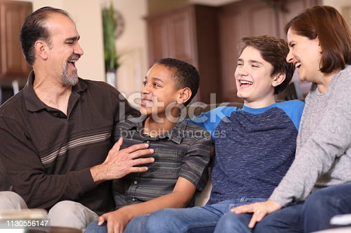 istock Multi-ethnic, adoption or foster care family at home. 1130556147