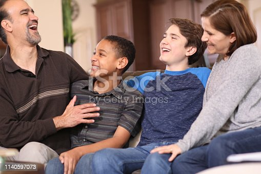 istock Multi-ethnic, adoption or foster care family at home. 1140597073
