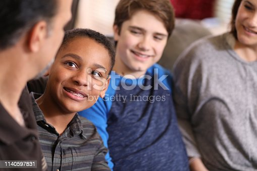 istock Multi-ethnic, adoption or foster care family at home. 1140597831