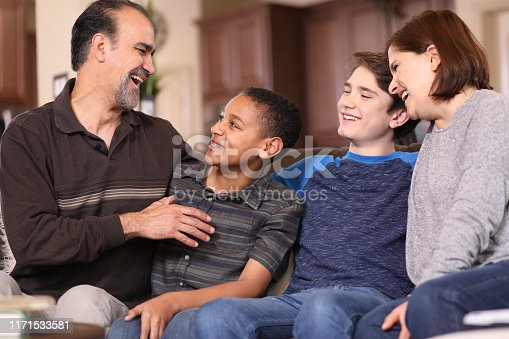 istock Multi-ethnic, adoption or foster care family at home. 1171533581