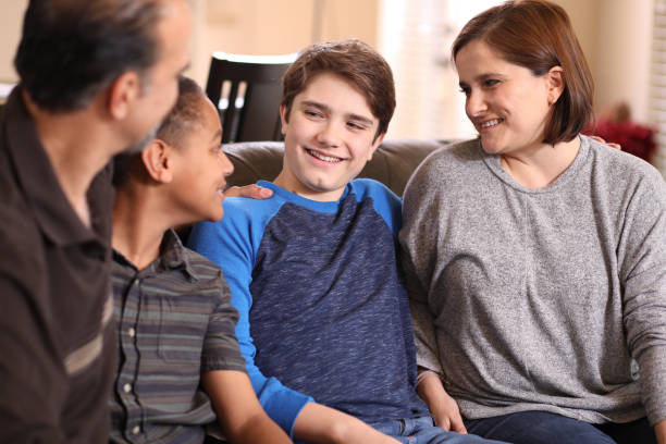 Multi-ethnic, adoption or foster care family at home. stock photo